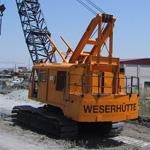 Grúa excavadora sobre orugas de segunda mano Weserhütte W180 con elevado tiro directo de cabestrante